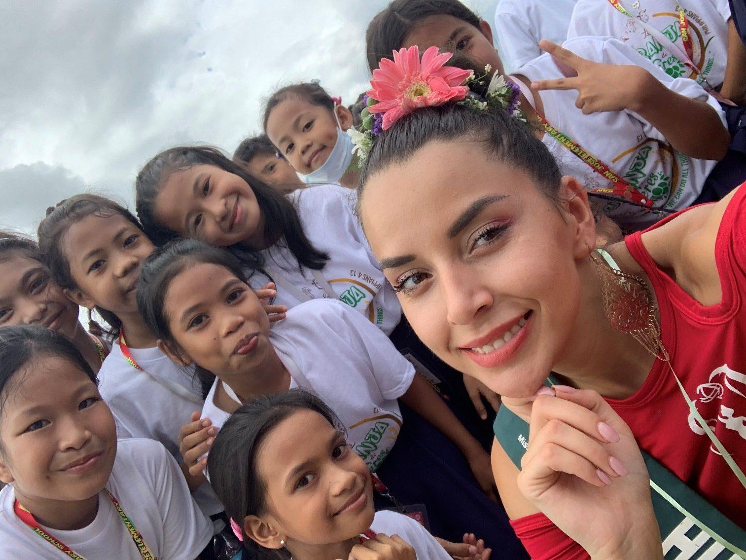 Tünde with local children